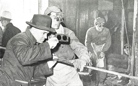 A Soviet expert helps furnace workers at the Taiyuan Steel Mill in smelting high-grade steel