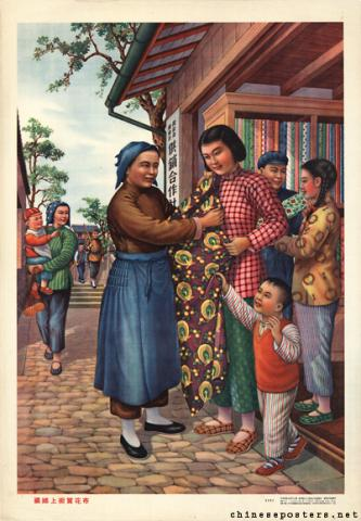 The young married woman buys a cotton print in the street